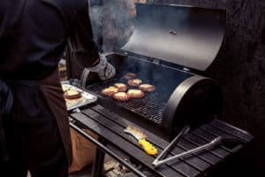 Charcoal grill cooking cheeseburgers