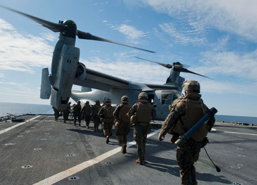 Military personnel boarding V-22 Osprey